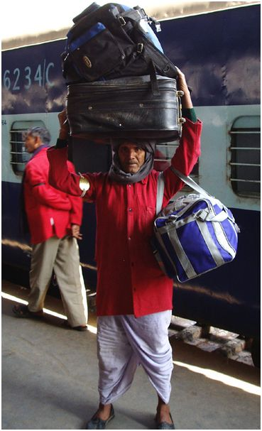 Indian Railway Coolie. The term 'coolie' is as overloaded and weighed down as the porters it denotes in India!