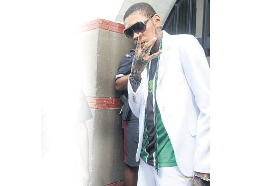 Vybz Kartel flashes the 'Gaza' sign as he exits the Supreme Court in downtown Kingston yesterday. The entertainer was given life imprisonment with the possibility of parole after 35 years for his role in the August 2011 murder of Clive 'Lizard' Williams. (PHOTO: BRYAN CUMMINGS)