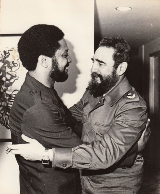 Maurice Bishop being embraced by Fidel Castro